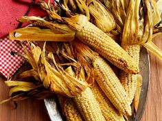 Cooking corn on the grill is easy. Just remove the silk, then fold the husk back up and put the whole ear on the grill to create Smoky Corn on the Cob.