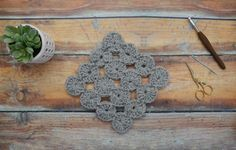 Although it looks intricate, it really only requires knowledge of the chain, double crochet, and slip stitch.