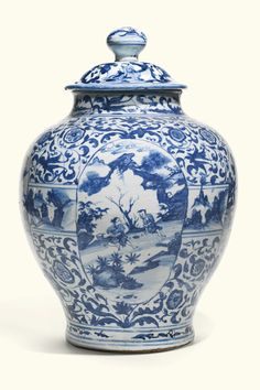 A LARGE CHINESE BLUE AND WHITE PORCELAIN JAR AND COVER, 17TH CENTURY, of baluster form, the exterior decorated with four oval cartouches, all reserved on meandering floral scrolls, the rim and foot with floral bands, surmounted by a domed cover painted with circular roundels, reserved on a ground of floral sprays, the knob decorated with landscape 49cm