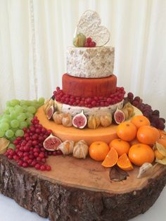 A four tiered autumn wedding cake made from; Belton Farm Red Fox, Belton Farm Vintage Cheddar, Wensleydale & Cranberry, Lancashire with Apricots, Redwood Smoked Cheddar, Long Clawson Blue Stilton and a Neufchatel Brie Heart.