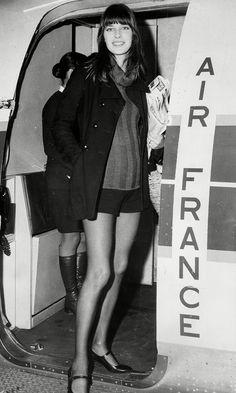 Jane Birkin wearing a turtleneck under a jacket with shors