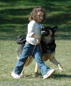 This is what I was doing at 10 yrs old even though this girl looks a lot younger. I enjoy obedience training. My dog Sasha and I were awarded best in the obedience class and I was the youngest one in there. Oh yea! lol