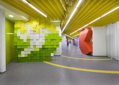 Top 10 Headquarters Interior Designs Of 2013 A fun and playful design is that of the Yandex headquarters in St. Petersburg. It was a project by Russian studio Za Bor Architects. The space has a 200 meter long corridor with office spaces featuring fun shapes and details such as a window shaped like the play button, the @ symbol or the Pacman logo.