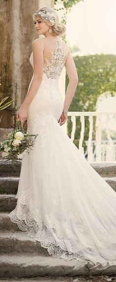 Essense of Australia wedding gown features a unique three-tiered skirt and extra-long cascading train