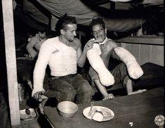 Sgt. Edward F. Good feeds Pfc. Lloyd Deming a leg of Christmas turkey.