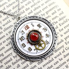 THE RED 12 CABPWF109  $28.00  Antique white enamel pocket watch face necklace with fire agate accents.