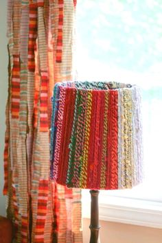 colorful rope lamp shade - or twine burlap or strips of cloth! fun way to use up extra rope/yarn, re-purpose a old lamp shade and add some textile texture to a room. Carillons Diy, Diy Crafts, Diy Floor Lamp, Rope Lamp, Fabric Lampshade, Lampshade Ideas, Lamp Ideas, Lampshade Redo, Lamp Shade Diy Ideas
