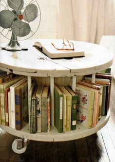 A bookcase/coffee table made out of a wooden cable reel |Pinned from PinTo for iPad|