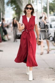 Alexa Chung in a red belted dress with white tshirt and white ankle boots