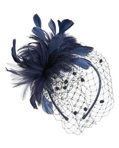 Tilly Fascinator £39. good the know that some at the back get irritated by too large of fascinators. this one is quiet