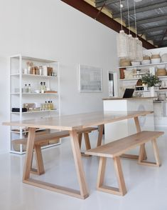 RAW Sunshine Coast furniture showroom. Picture features our STARK dining table and bench seats in solid timber