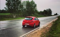 red opel corsa opc on the road