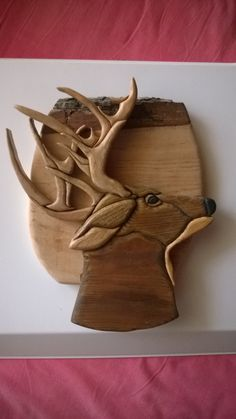 The deer was made using the beatifull and natural locust wood and pine. Intarsia 3 D style as seen in different thickness parts and burnish. It