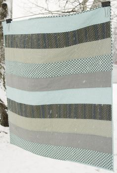 full front Modern Baby Boy Quilt by knitsandbitsforbaby on Etsy... May  do one like this but squares instead of strips..