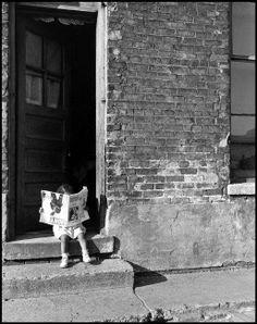 "Photo © Wayne Miller/Magnum Photos USA. Illinois. Chicago. 1947. A girl ""reading"" Ebony magazine."