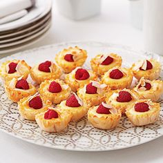 Add these tiny tarts to your holiday buffet table. They're easy to make thanks to purchased phyllo shells and the homemade lemon-lime curd and raspberry filling is totally divine.