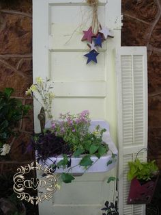 found plastic wall mail boxes at goodwill today...will mount on old door outside to hide my spade, pruners, scissors and ties for vines. :0)  Also can use others for planter boxes screwed to door, fill with trailing plants.