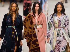 Burberry A/W runway show where coats are worn swaddled with multi-tonal scarves cinched with a narrow belt - winters hottest look!