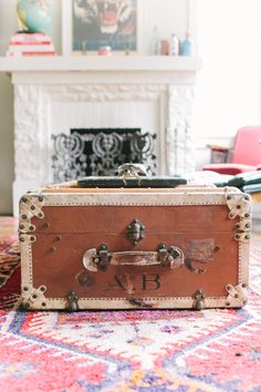 suitcase for a coffee table + that fireplace