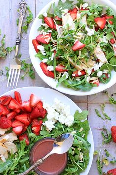You'll love this healthy and delicious summer salad! Strawberry Arugula Salad with  Chicken, Goat Cheese, Almonds, and Creamy Strawberry Lemon Vinaigrette