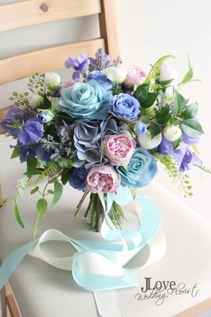Bridal bouquet in blue、purple and pink. includes the lovely sweet pea