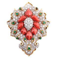 DAVID WEBB. A Coral Diamond and Emerald Brooch.