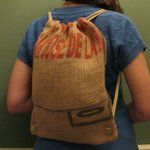 """This mini backpack is made from re-purposed burlap coffee bean sacks. Designed with accessible open top and zippered outside pocket. Measures 12"""" x 15"""""""