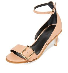 Ilana sandals by Tibi. Smooth leather Tibi sandals with a polished buckles at the vamp and slim ankle strap. Inset, covered heel and leather...