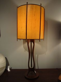 """The Betty Grable"": walnut table Lamp with curvy, great legs. Original walnut-ribbed shade."