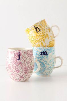 these are GREAT gifts for a bridal shower or wedding gift! my husband and i still drink our coffee out of our black & white monogrammed anthro mugs!