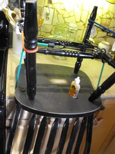Bungee cords to hold the chair in place whilst gluing. Genius!