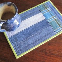 Mug rug, upcycled denim strips with blue and green plaid Jean Crafts, Denim Crafts, Table Runner And Placemats, Quilted Table Runners, Small Quilts, Mini Quilts, Mug Rug Patterns, Place Mats Quilted, Recycled Denim
