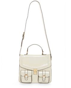 Structured white bag perfect for flowy, pastel outfits.