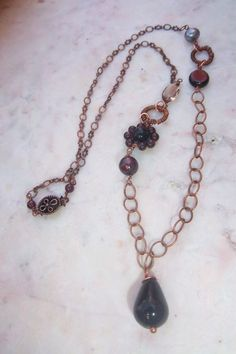 Black agate and garnet wire wrapped necklace by mooliemarket, $35.00
