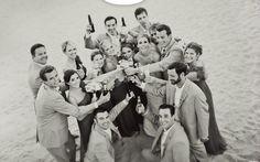 """Cheers"" wedding party photo"