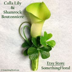 Green Calla Lily and Lucky Shamrock Clover Boutonniere by Something Floral. Irish of Celtic themed wedding? St. Patrick's Day party? Attending prom or homecoming and want to sport something unique and original on your lapel? Just want to flaunt your inner Irish (whether actually Irish in heritage or only in spirit)? If so, this boutonniere is for you. #green #calla #lily #shamrock #lucky #clover #boutonniere #boutonierre #buttonhole #wedding  #prom #homecoming #StPattysDay #StPatricksDay…