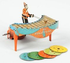 1519: Tin Litho Wolverine Xylophone Player Wind-Up Toy. : Lot 1519