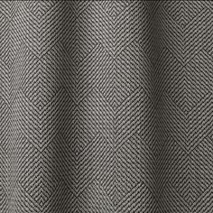 DECO' col. 003 by Dedar - A rounded crinkle yarn is alternated with fine fabric braid to confer a rippled surface; the motif created by the weave is a geometric lozenge pattern. Decò is woven on special looms enabling the use of different bulky yarns. The interlacings on the reverse side add stability to the fabric when being made up. Its weight and resistance to abrasion make it ideal for upholstery applications.