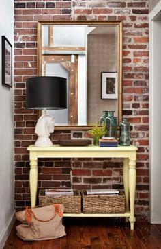 Suzie: Capella Kincheloe Interior Design - Small foyer hall with exposed brick wall, mirror, ...