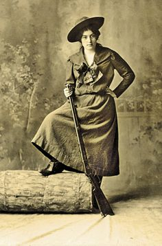 With her standard-grade Winchester Model 1892 lever-action, repeating magazine rifle in hand, this latter-day huntress in wide-brimmed hat, middy blouse and skirt strikes a rather risqué pose for the time.  – Courtesy Dickinson Research Center, National Cowboy & Western Heritage Museum, 2004.045 –