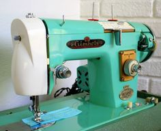 a gorgeous bright teal Gimbels sewing machine from the 60's