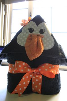 Girly penguin hooded bath towel with washcloth.