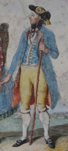Blauer, knielanger, einreihiger Rock, rot gefüttert. Hellblau gemusterte Weste, Kanten mit weißer oder silberfarbener Borte eingefasst, ab Brusthöhe aufgeknöpft, darunter schaut weißes Hemd hervor. Gelbe Kniebundhose mit Latz. Schwarz-rotes Halstuch zur Schleife gebunden. Schwarzer Dreispitz verziert mit schwarzem Hutband mit Goldfransenbesatz an den Bänderenden und aufgenähter