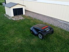 A small homemade house built for the robotic mower.