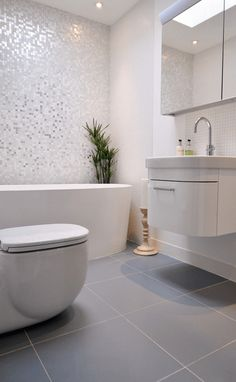 Different Floor And Shower Tile - A light colored bathroom uses different styles and sizes of tile