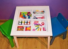 Am loving that there are plans and everything down to your specific cuts needed for this crafty kids table with supplies hidden under a piece of acrylic!
