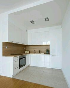 The design of the dream kitchen using white collaboration with wooden floors is . - The design of the dream kitchen using white collaboration with wooden floors is very suitable to loo - Simple Kitchen Design, Kitchen Room Design, Kitchen Cabinet Design, Home Decor Kitchen, Interior Design Kitchen, Home Kitchens, Decorating Kitchen, Kitchen Ideas, Luxury Kitchens