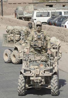 Australian Special Forces (SASR) riding special purpose 6-wheeled ATVs