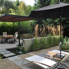 Terrasse minérale et végétale avec bassin