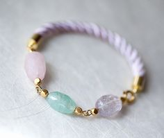 i Beauty Pastel Candy Colored Amethyst, Green Fluorite and Rose Quartz gemstone bracelet with delicate pink cord.